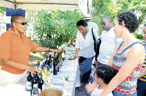 South African High Commissioner Mathu Joyini (left) selling South African wines at last year's bazaar.
