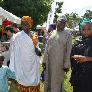 A Nigerian family enjoying the Bazaar wearing their national dress.