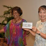 emiko-hands-over-donation